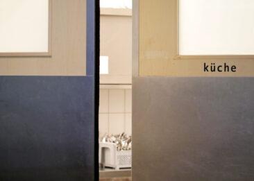 Restaurantfotografie Tür zur Küche